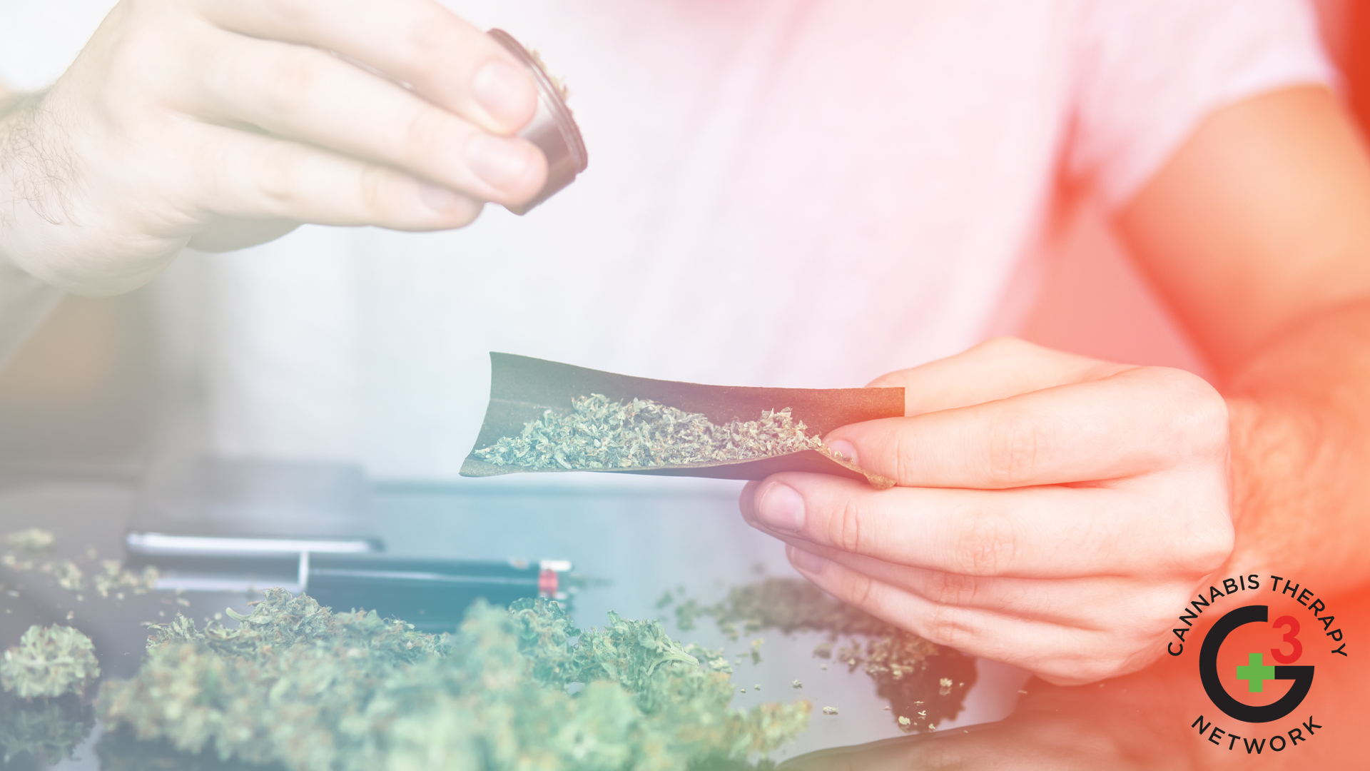 Man rolling a marijuana joint
